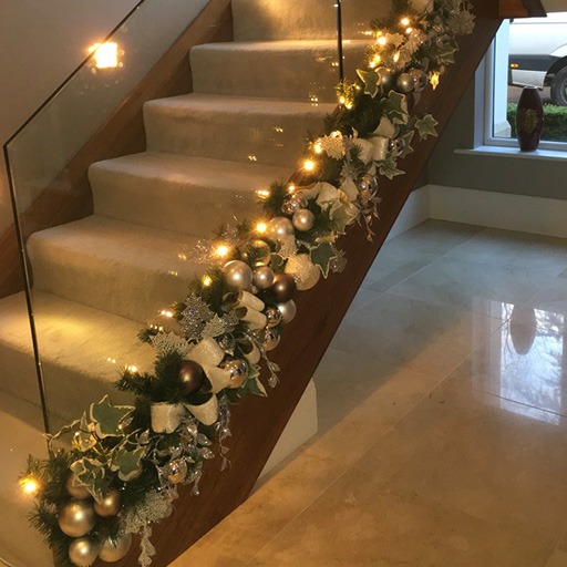 Staircase decorated with wreath and baubles