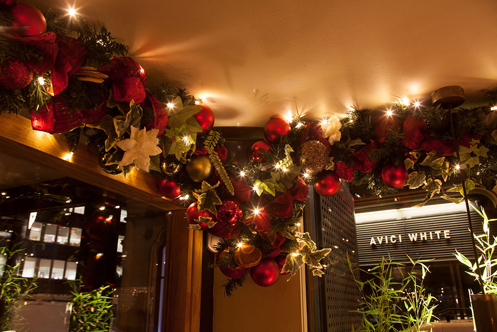 Baubles and ivy handing from ceiling