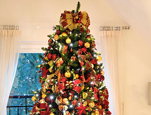 Large Christmas tree decorated with red christmas decorations
