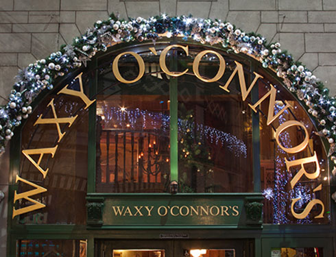 Waxy O'Connor's doorway decorated with Christmas wreath