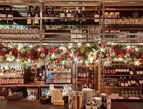 Bar decorated with christmas wreaths and baubles