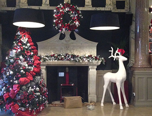 Room with Christmas decorations and large white reindeer