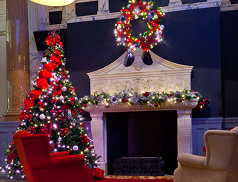 Fireplace with Christmas wreath and red christmas tree