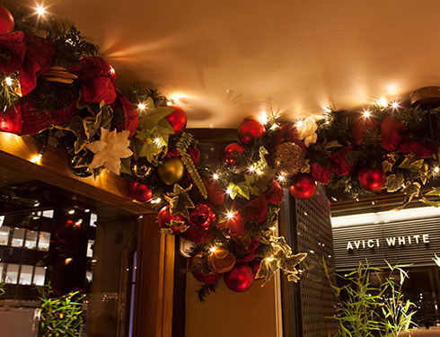 Ceiling decorated with christmas garland and baubles