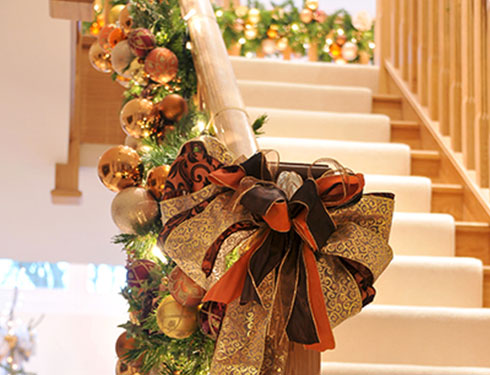 Stair case decorated with baubles and ribbons