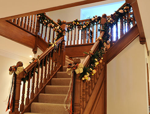 Home staircase decorated with Christmas decorations