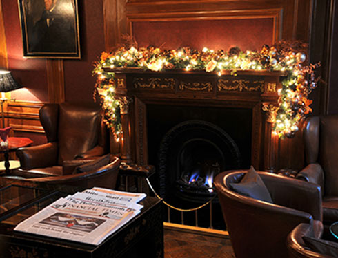 Fire place with christmas decorations and lights